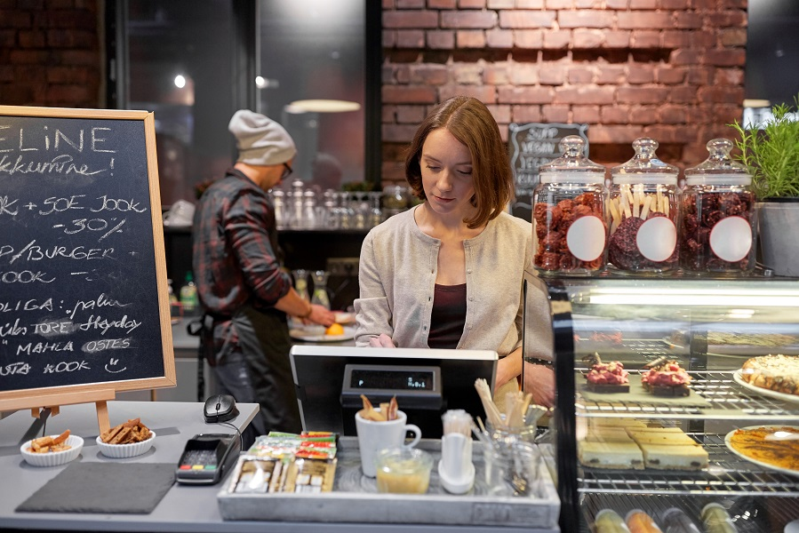 woman-or-barmaid-with-cashbox-at-cafe-PKRWNNC